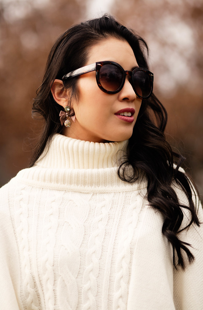 cute & little blog | white cable knit poncho, j.crew bow earrings, karen walker super duper sunglasses | winter outfit