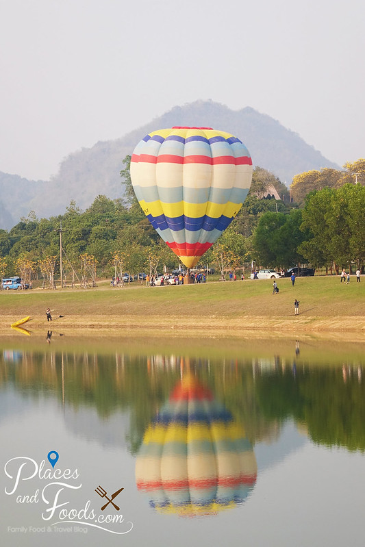 singha park international hot air balloon rainbow single reflection