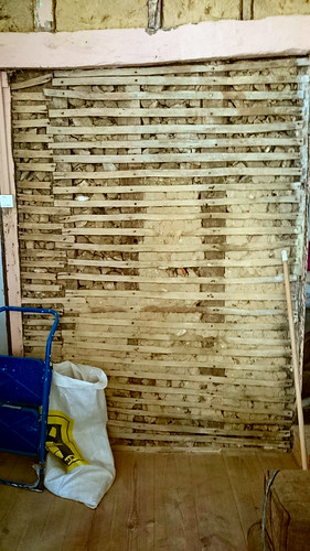 Lath and plaster wall half cleaned up