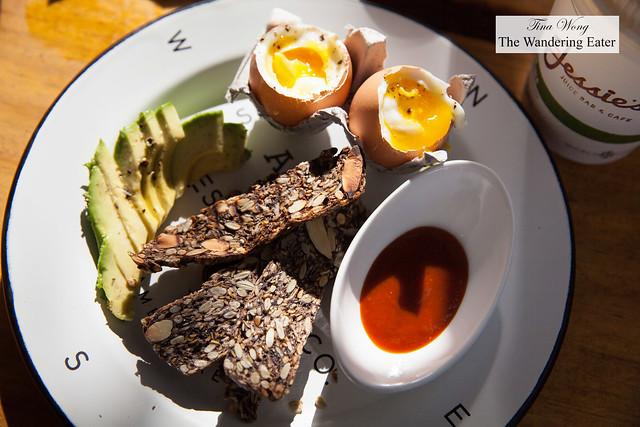 Soft boiled eggs, nut toast, avocado, Bomb sauce