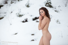 Woman in snow nude