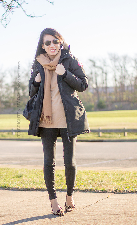 black parka, camel scarf, camel sweater tunic, leopard flats