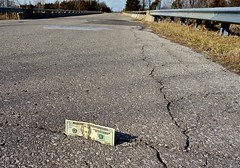 An Encounter with a Twenty Dollar Bill Stuck in a Crack Up on Lind Road