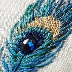Ready for a close up.  Appliqué peacock feather with swarovski elements and hand embroidery #swarovski  #swarovskielements #handembroidery #peacock #peacicknecklace