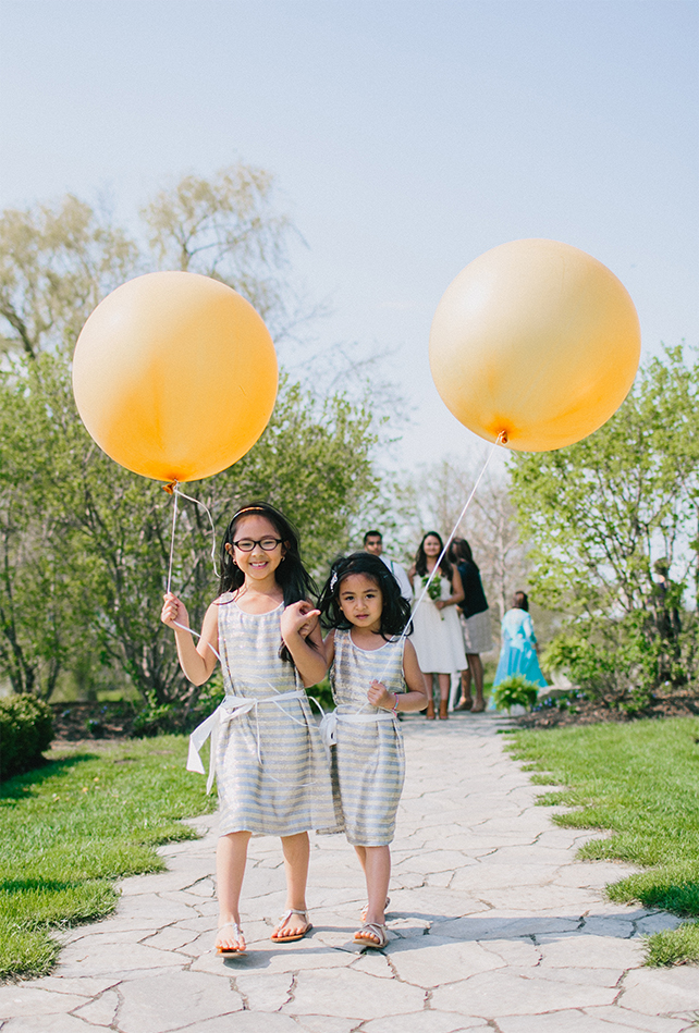 Flower girls held Giant balloons for Garden Chic wedding in Ontario The bride wears #BHLDN wedding dress | Photography: Fern Shin Photography | Read more on Fab Mood - UK wedding Blog #gardenwedding