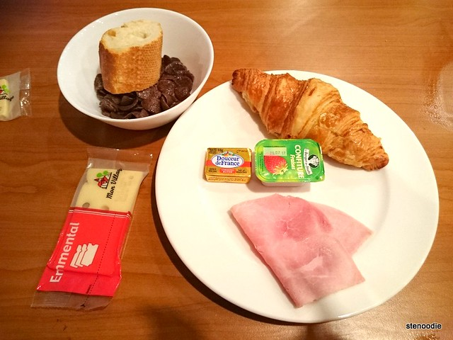 Croissant, ham, cereal, cheese breakfast