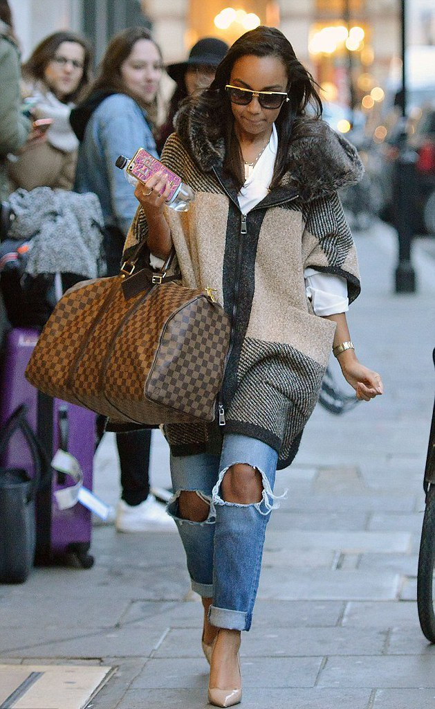 zara-tweed-poncho-nude-high-heels-Louis-Vuitton-handbag-knee-ripped-boyfriend-jeans-large-glasses,ripped skinny jeans, hi top wedge trainers, black coat with shearling collar, black fringe shoulder bag, gold hoop earrings, distressed jeans, ripped jeans, how to style ripped jeans