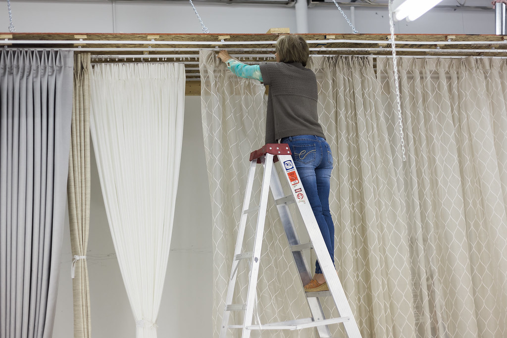final touches being put on custom draperies in workroom