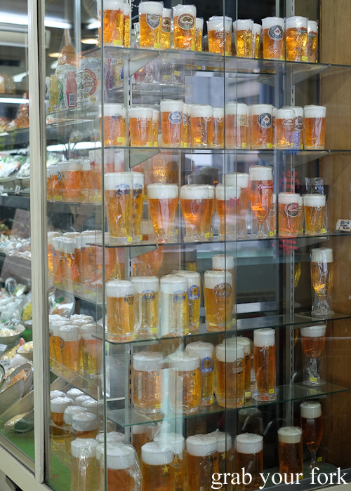 Plastic steins with beer and foam in Kitchentown on Kappabashi Dori in Tokyo