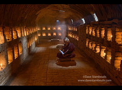 A young monk praying in the temples of Bagan, Myanmar