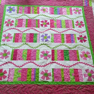 A beautiful quilt for project warmth is now quilted for my Aunt Jane.