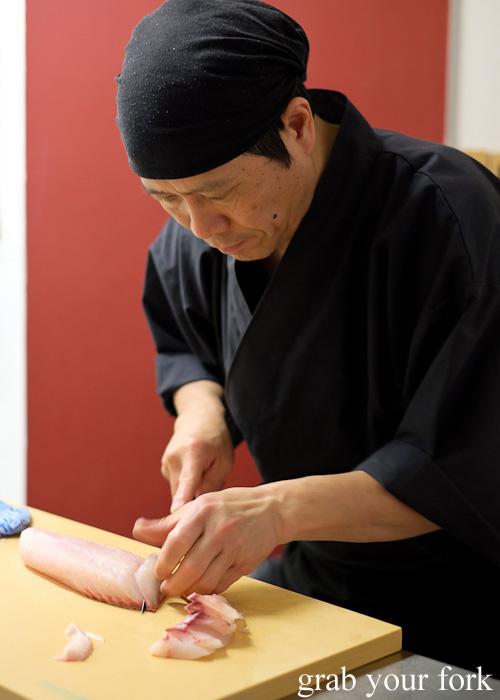 Chef Shinji Matsui slicing bass grouper sashimi at Sashimi Shinsengumi, Crows Nest