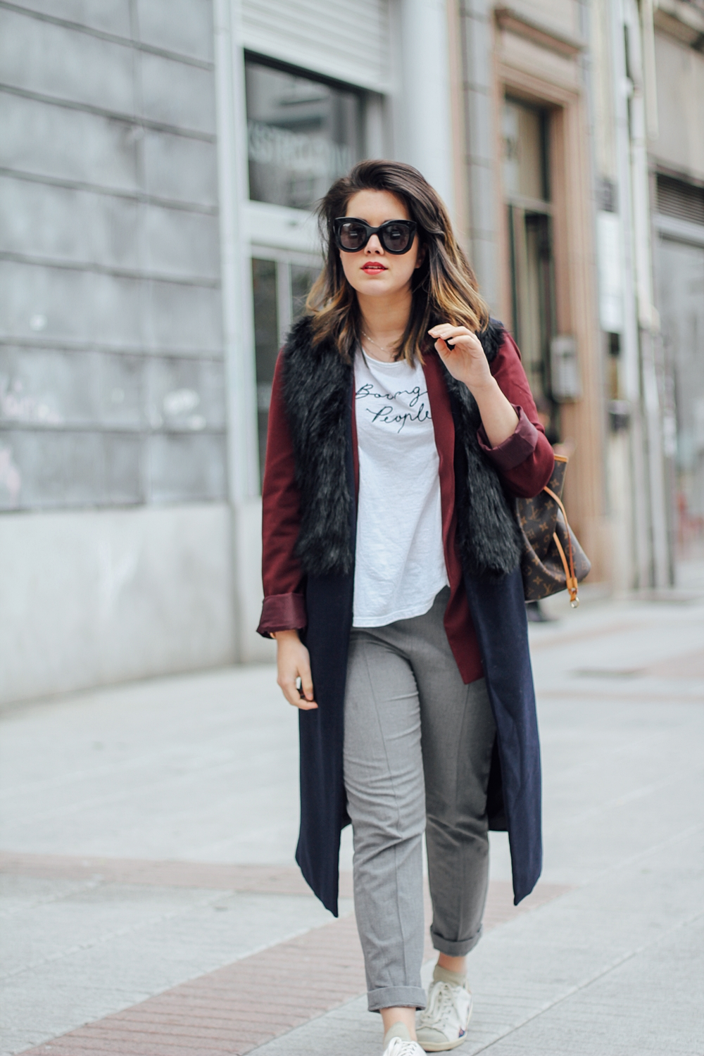 isabel marant sneakers with faux fur vest and red blazer streetstyle myblueberrynightsblog