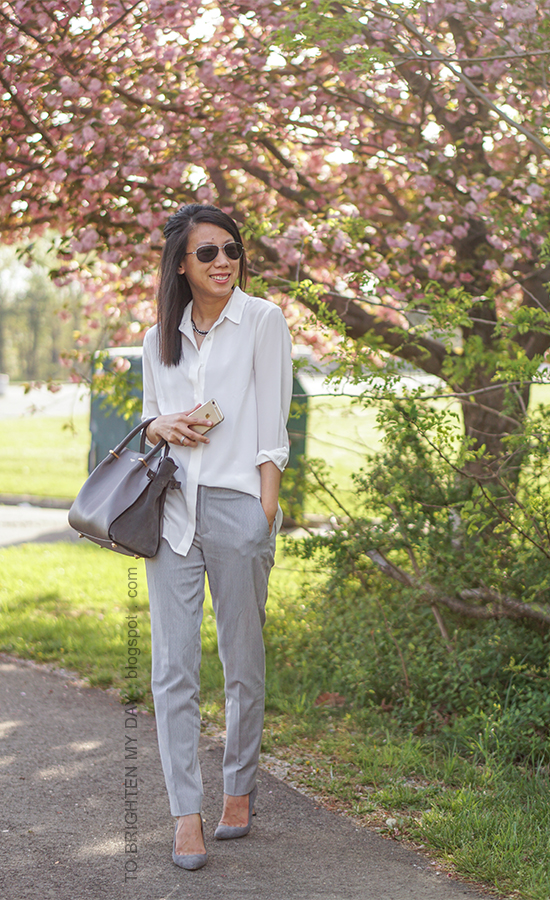 gunmetal necklace, white silk button up shirt, gray pants, stacked rings, gray suede pumps