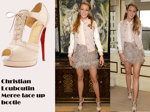Blake Lively in Christian Louboutin Meree lace up bootie, feather miniskirt & Varsity jacket