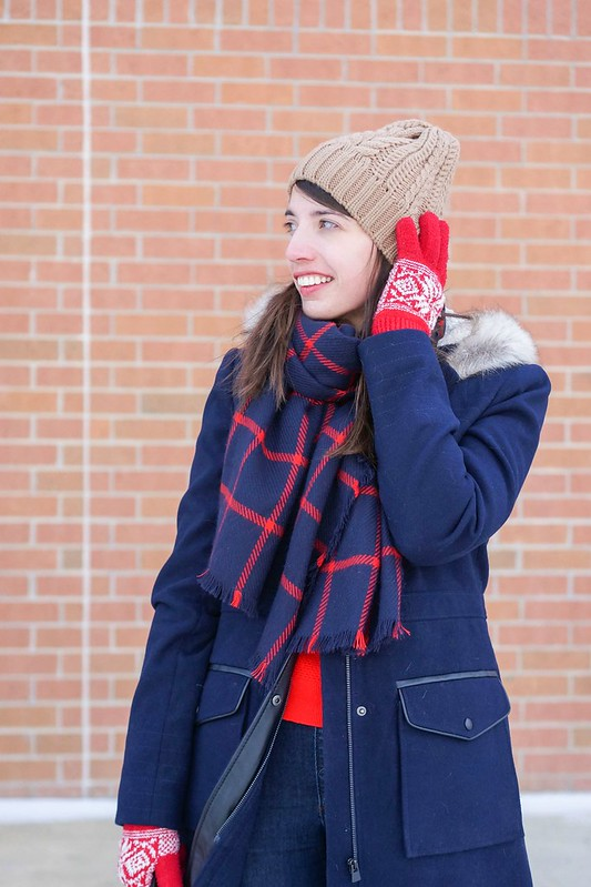 navy coat + red scarf + red sweater + Loft jeans