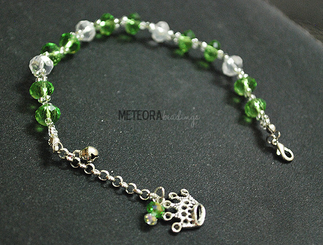 Bracelet - green and clear beads with silver crown charm