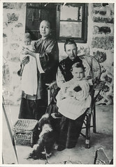 Women and children posing for a photo