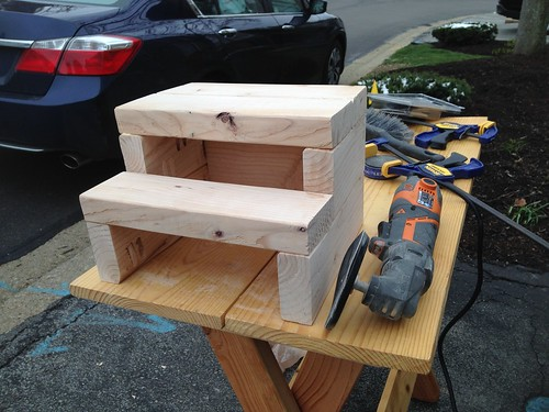 Sanding 2x4 step stool using multi-tool with sanding disc