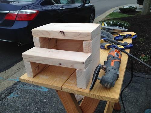 Sanding 2x4 step stool using multi-tool with sanding disc