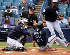 Yankees catcher Carlos Corporan tags out Atlanta's Ender Inciarte