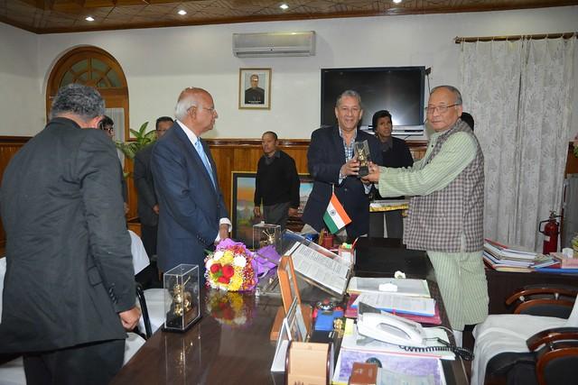 Chief Minster of Manipur presenting a memento to Shri Ranjit Barthakur, Chairman FICCI, North East