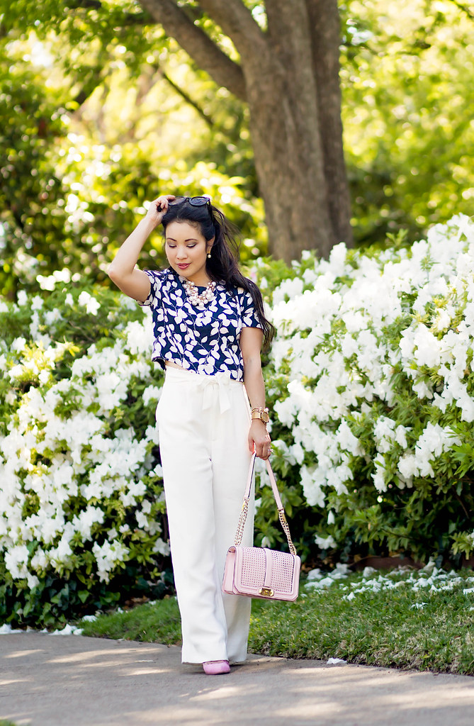 cute & little blog | petite fashion | chelsea28 wide leg white pants, floral crop top, minkoff pink love crossbody, pearl necklace | spring outfit