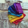 Look at this stack of lucious color! They're all ready to be made into blocks for my #ScrappySwissCrossQuilt.