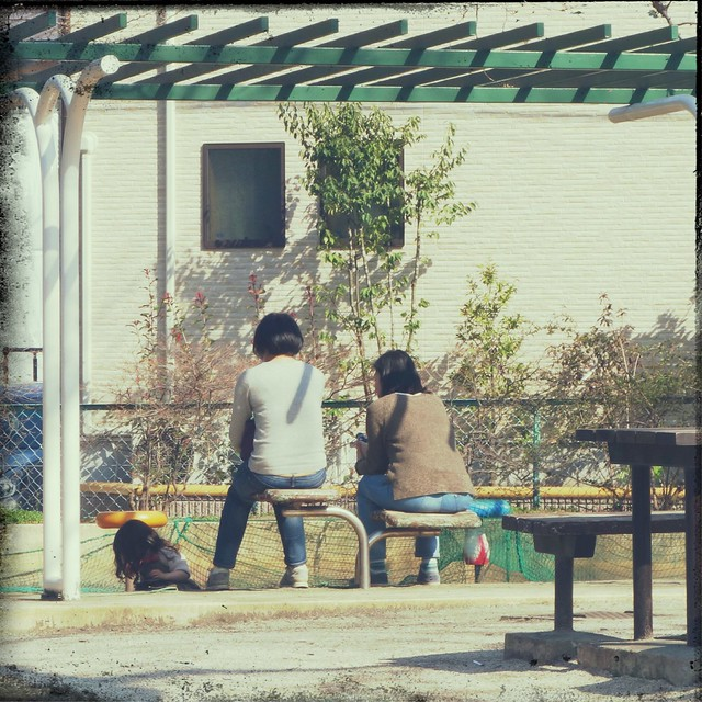 Mothers sitting on park bench