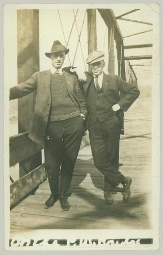 Two gentlemen on a bridge