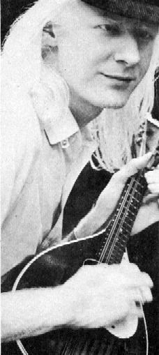 Johnny Winter playing a Mandolin