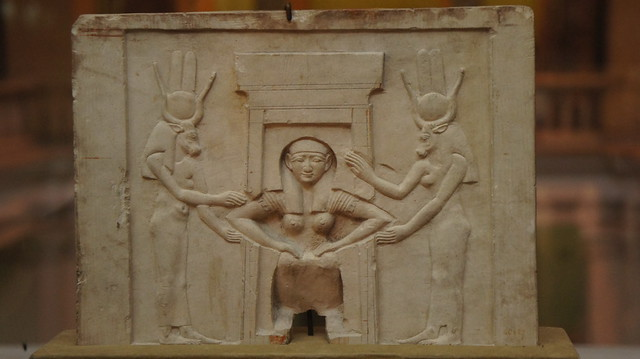 Ancient Egyptian woman giving birth aided by goddess Tefnut