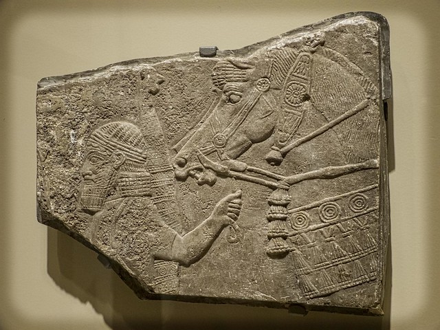 Relief fragment with warrior and horse Assyria (modern Iraq) 9th-8th century BCE Stone