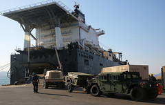 Marine Corps vehicles are discharged from Military Sealift Command's Maritime Prepositioning Force ship USNS PFC Dewayne T. Williams (T-AK 3009). (U.S. Navy/Grady T. Fontana)