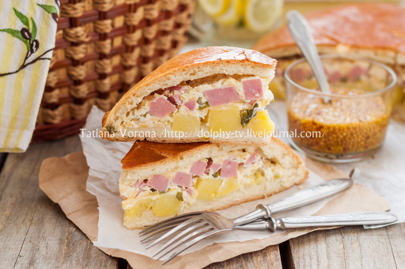 Two Pieces of Potato, Ham, Sour Cream and Cheese Pie