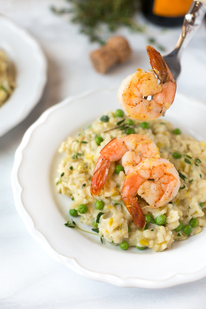 closeup of champagne and leek risotto with roasted shrimp