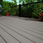 DuraLife Siesta decking in Coastal Grey with Black Railways railing and custom metal balusters