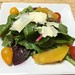 Spring salad with soy ginger viniagrette, orange segments, pear tomatoes, red beets and shaved parmigiano reggiano