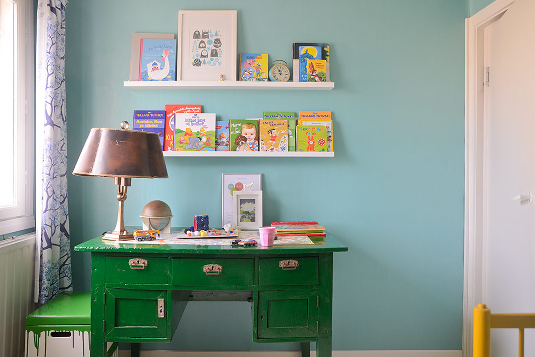 Green vintage writing table and Ikea Ribba picture ledges as book shelves