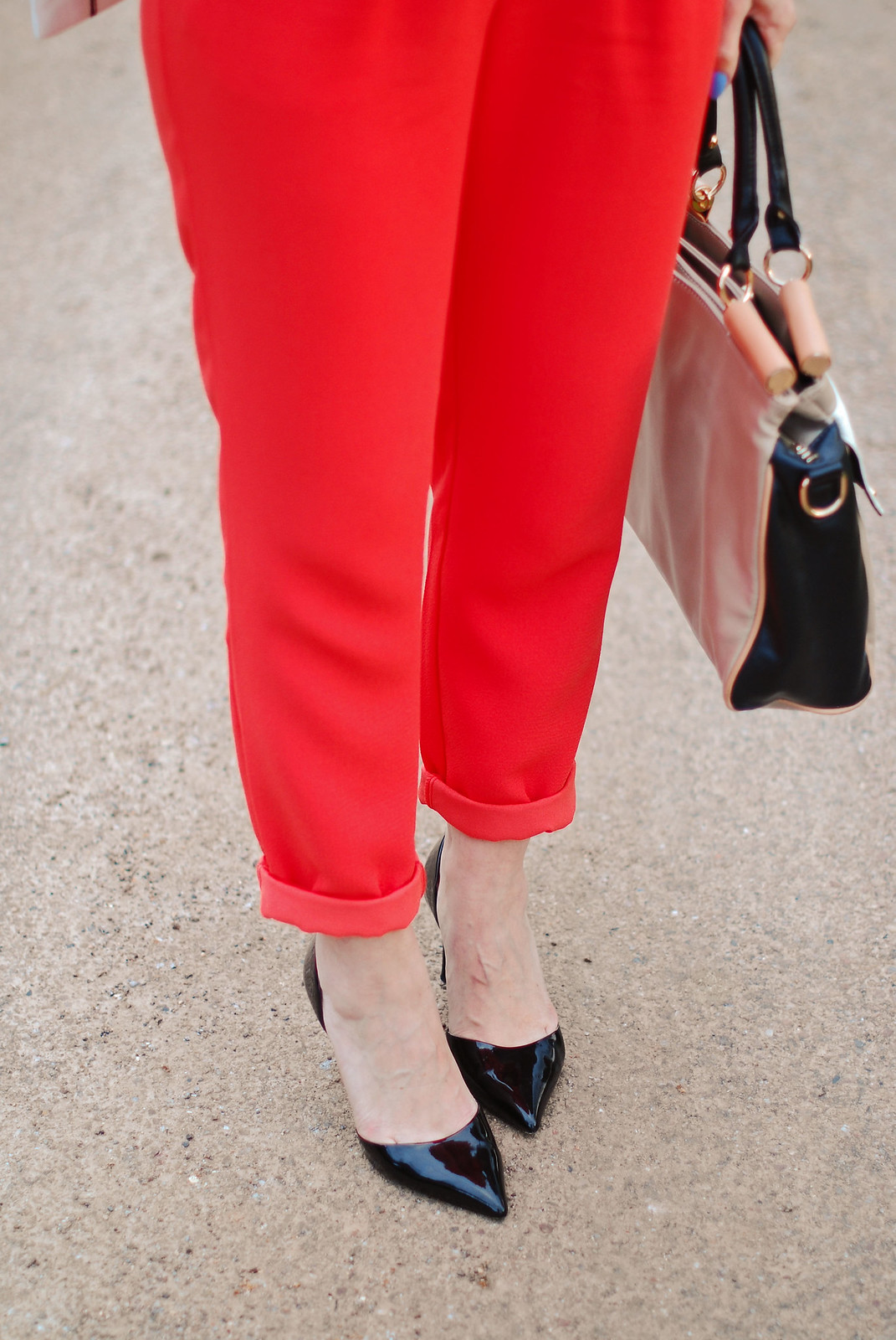 SS16: Orange short sleeved jumpsuit, black pointed toe heels, colour block bag | Not Dressed As Lamb