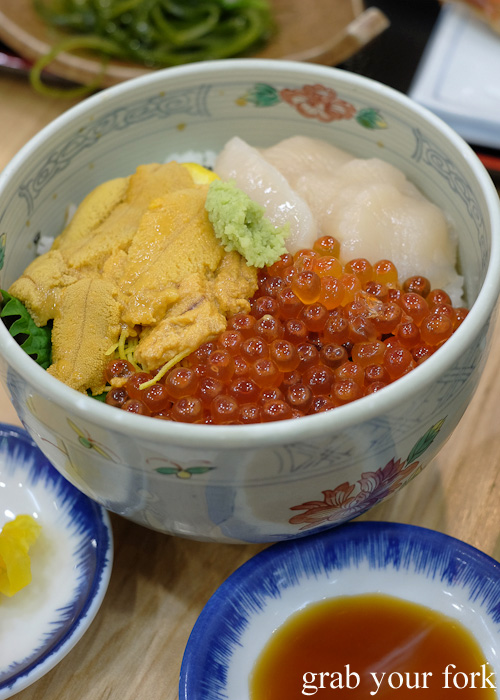 Hokkaido sashimi scallop, squid, sea urchin roe and salmon roe set from Asaichi Shokudo Makoto Yasube at Hakodate Morning Market, Hokkaido
