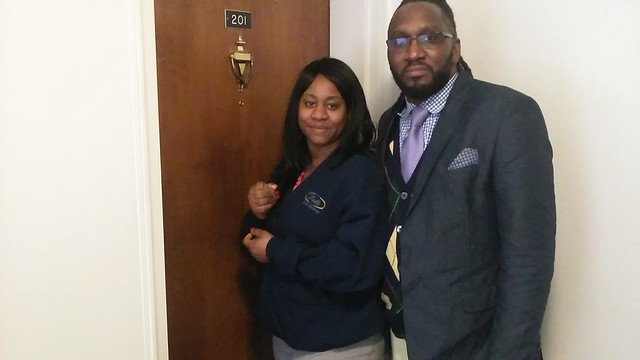 Monique Staley and Robert Williams standing in front of Staley's new apartment. | Photo by Reginald Black