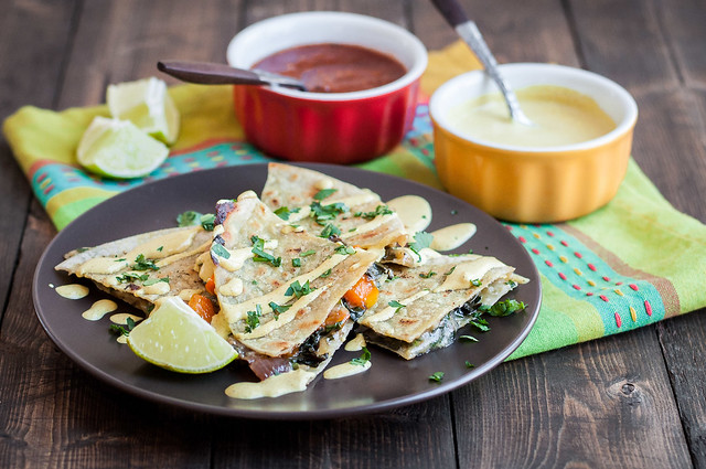 Make ahead curry kale quesadillas with Indian spiced sour cream--perfect weeknight dinner!