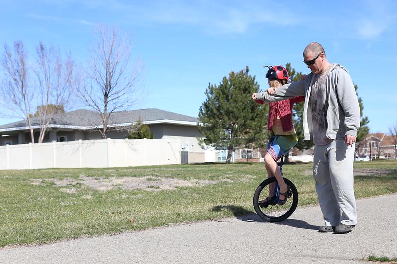 K working on her unicycle balance