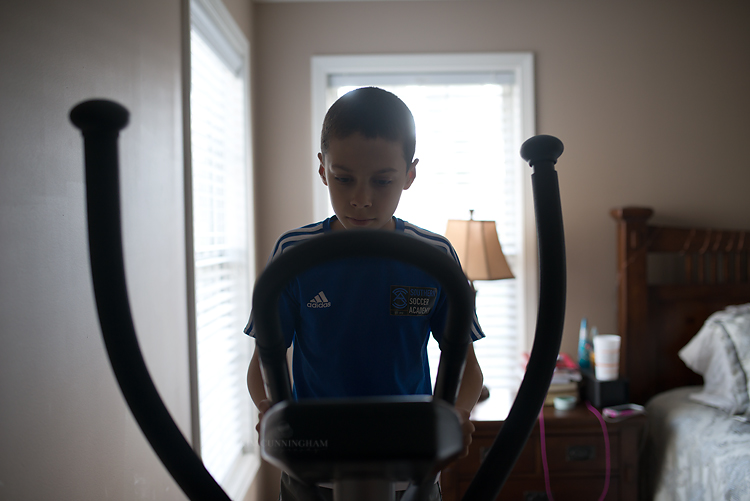 boy on elliptical machine 01-750