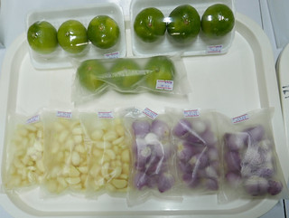 fresh limes, garlic and onions in a variety of plastic-like packaging