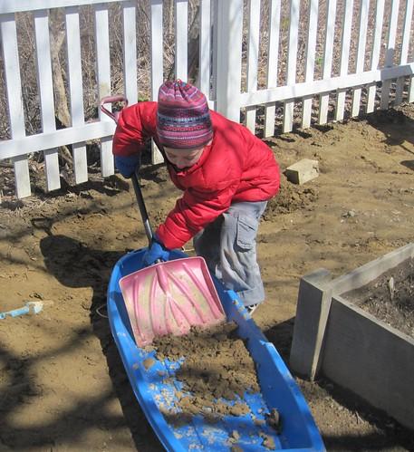 shoveling rubble