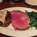 Rare prime rib, dry baked potato and green beans without butter
