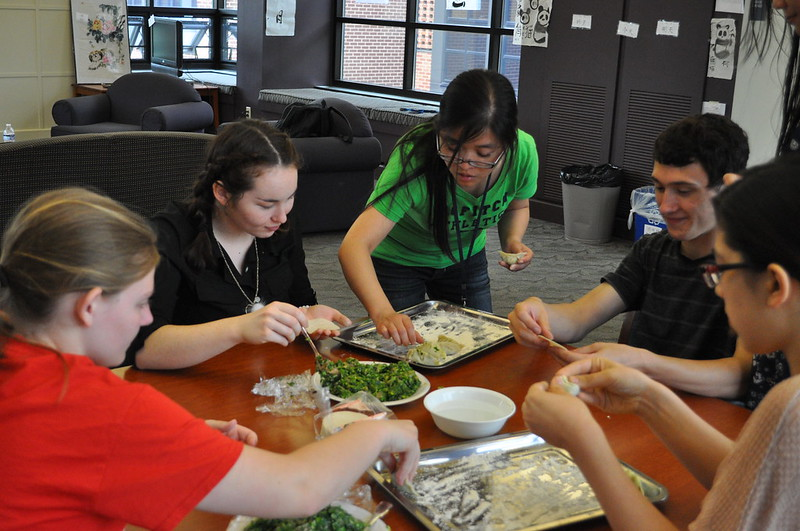 Sun, 07/07/2013 - 1:02pm - Instructor Hui Yu cooking with foreign language academy students.