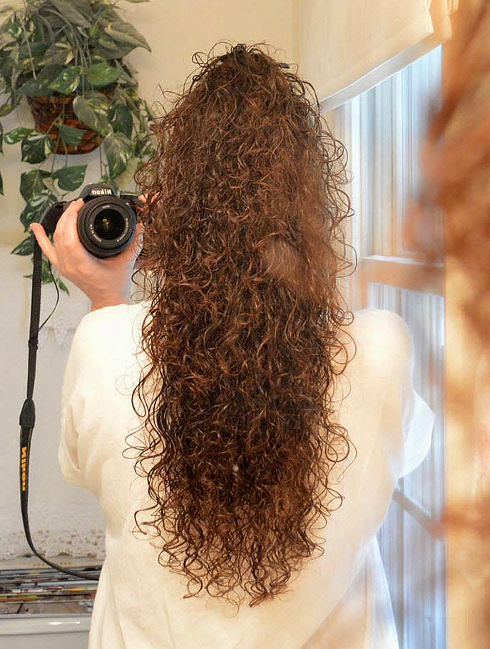 9 Audrey has long naturally curly hair